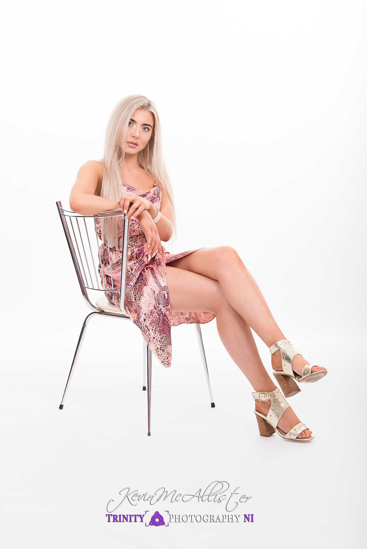 seated model, high key in dress