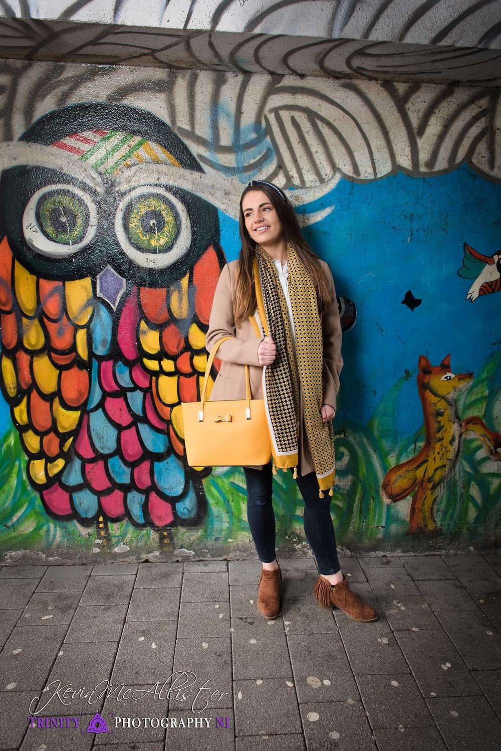 fahion model with handbag and scarf in a graffiti alley omagh