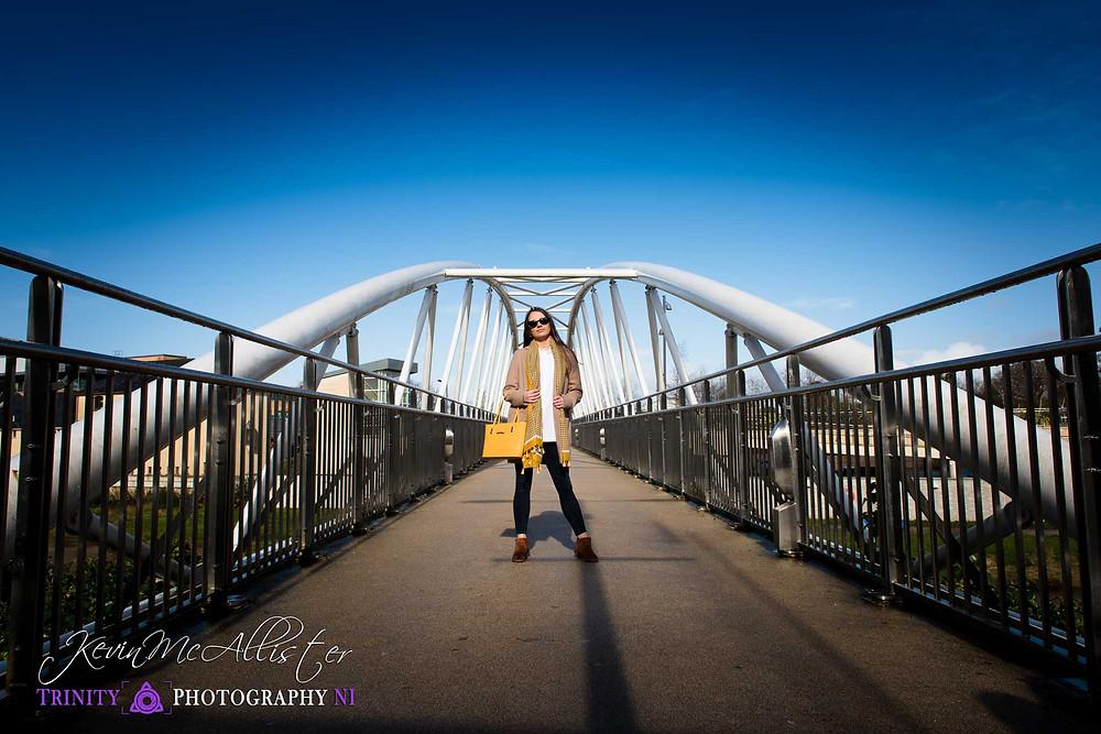 brunette model on footbridge in Omagh