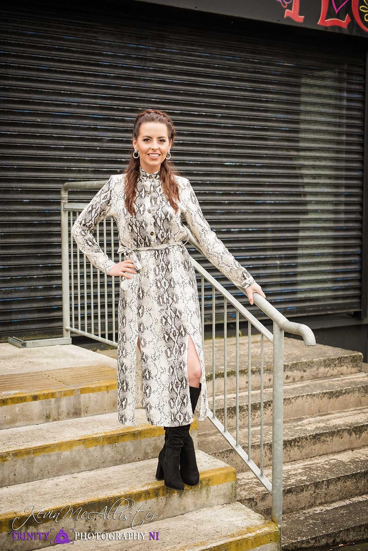 girl poses eside handrail,fashion