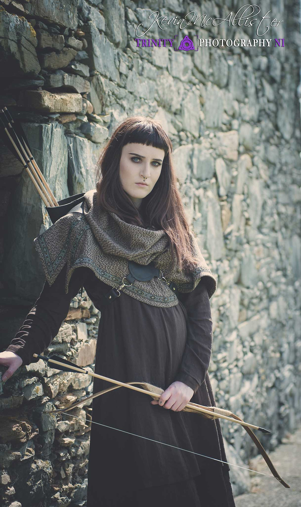 medieval  female Archer outside a castle in ireland