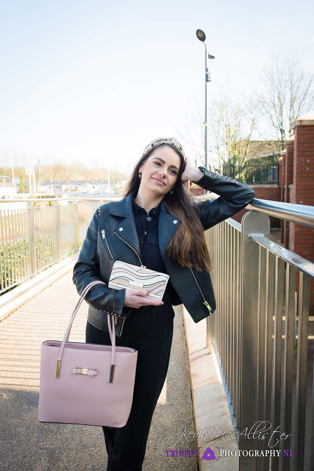 model and pink handbag with a matching purse.