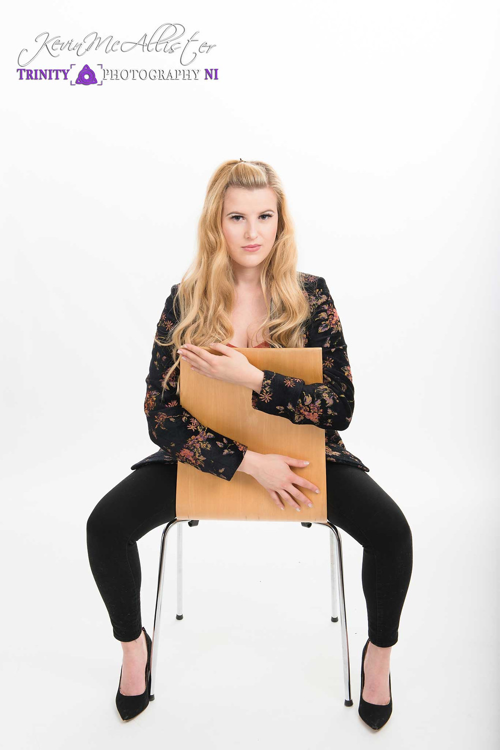 model seated in chair