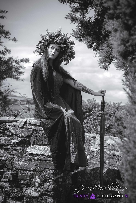 headress wearing warrior with sword