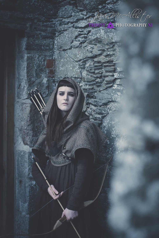 female medieval archer