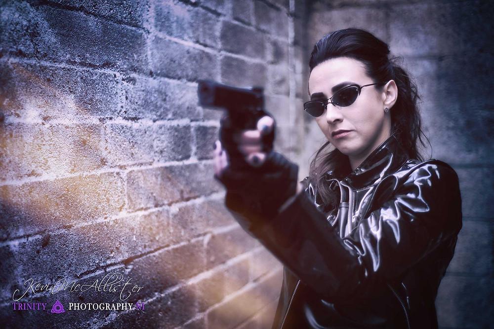 trinity matrix styled shoot with handgun