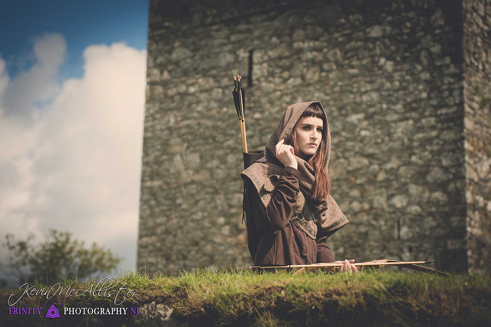 archer in front of a irish castle