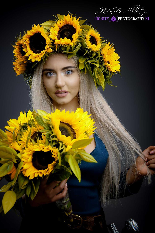 model in a sunflower head dress