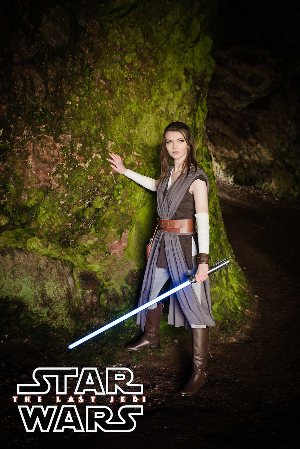 Rey cosplayer wielding lightsaber in cuhendun caves antrim coast ireland