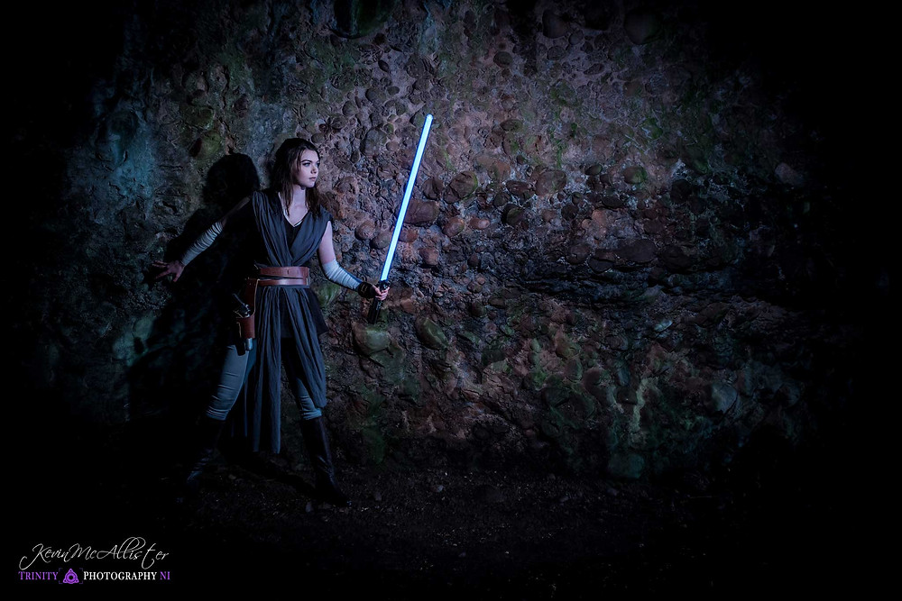 lightsaber lighting the way of rey star wars cosplayer cushendun caves ireland