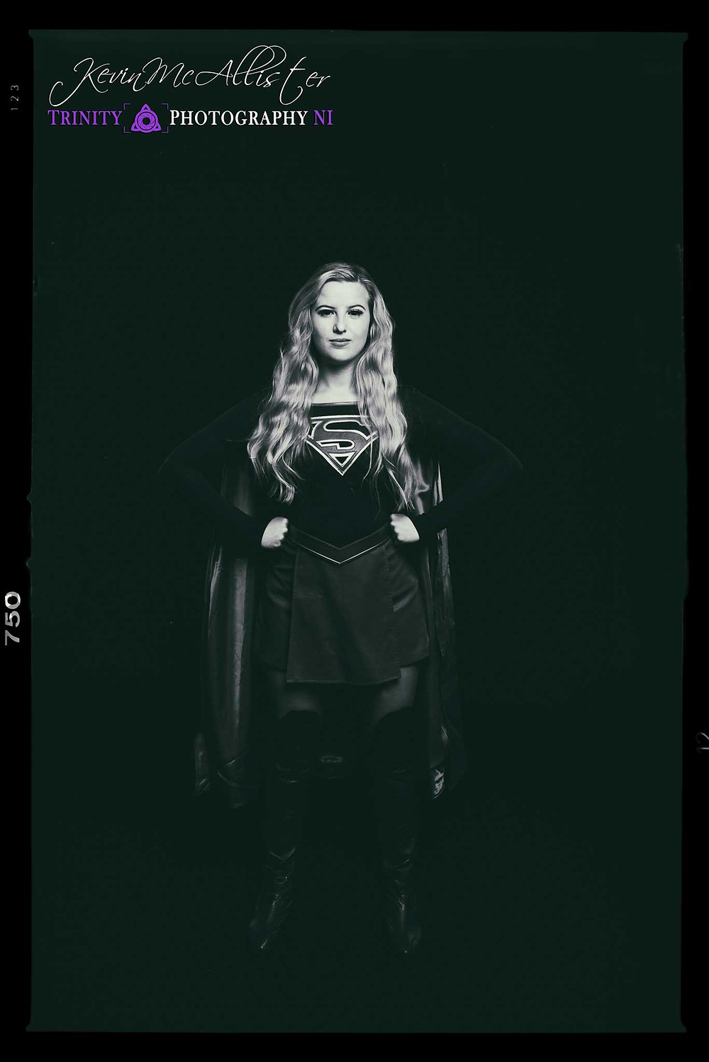 black and white image of supergirl standing pose