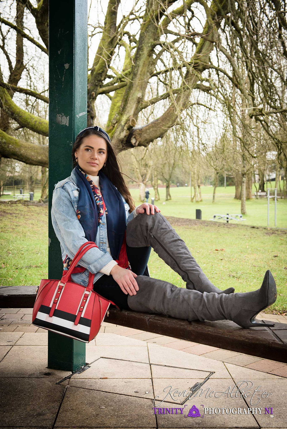 runette fashion model with knee high boots and fashion accessories.