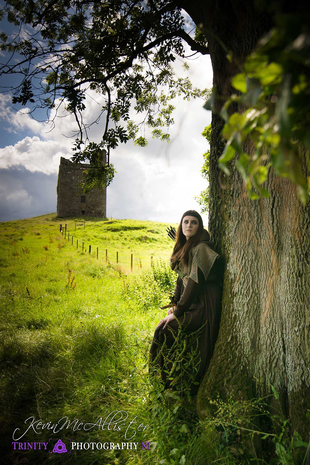 archer waiting with irish castle in the background