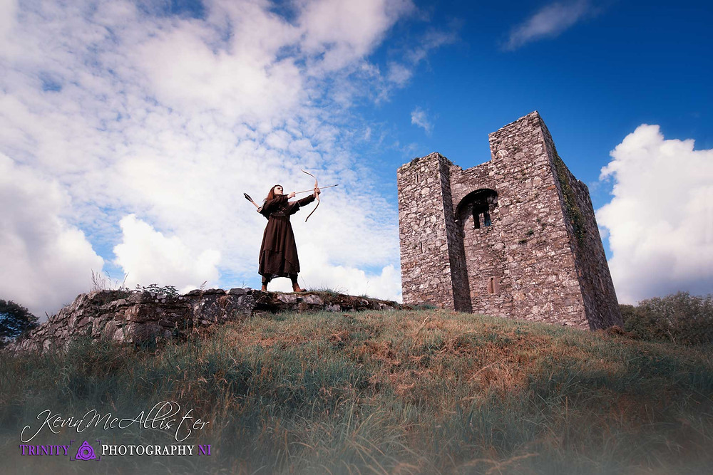 medieval archer poised to shoot at audleys castle