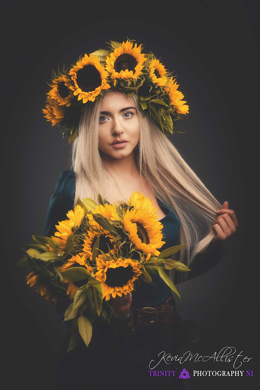 model in a sunflower headdress and bouquet
