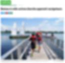 article de journal avec une photo d'un quai au bord de l'eau