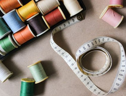 directly-above-shot-of-sewing-items-on-t
