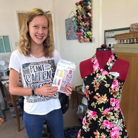 Rosalyn has made a halterneck floral dress