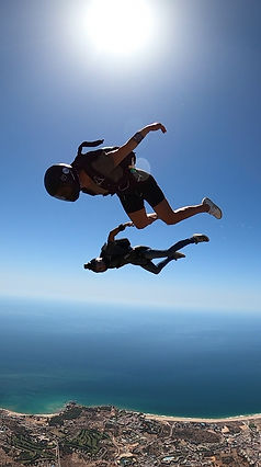 Skydivers Flying a Tracking Jump over Algarve – Angle Jump in Algarve - Learn Skydive Tracking in Algarve – The Skydiving Therapist – Skydive Tracking Coach in Portugal – Skydive Coach in the Algarve – Belly Tracking