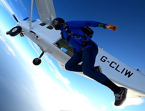 Skydiver performing a Tracking Exit - Tracking Jump over Algarve – Angle Jump in Algarve - Learn Skydive Tracking in Algarve – The Skydiving Therapist – Skydive Tracking Coach in Portugal – Skydive Coach in the Algarve – Belly Tracking – TR1 Sticker