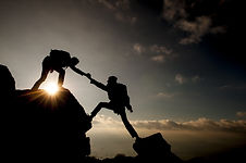 Couple hiking help each other silhouette
