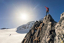 Climber or alpinist at the top of a moun