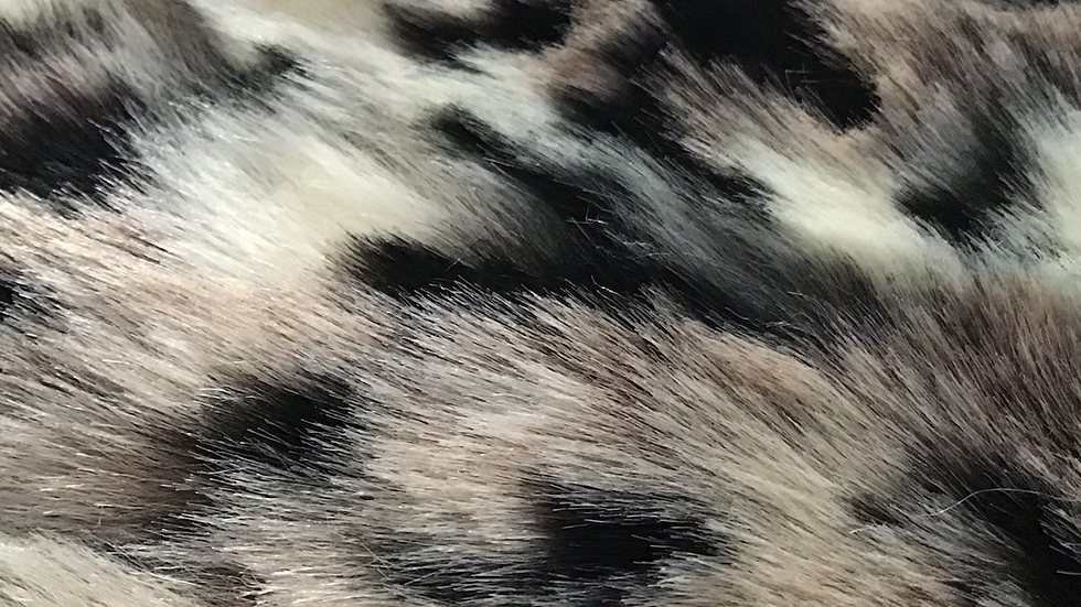 Unusual Natural Looking Faux Fur piece