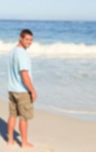 Happy, healthy man next to ocean
