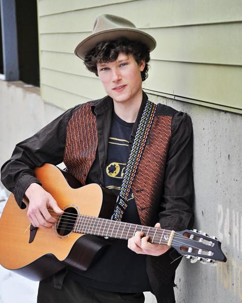 Posing with acoustic guitar, Boulder, Colorado