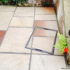 Hidden Manhole Cover in Patio