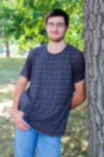 Senior by tree