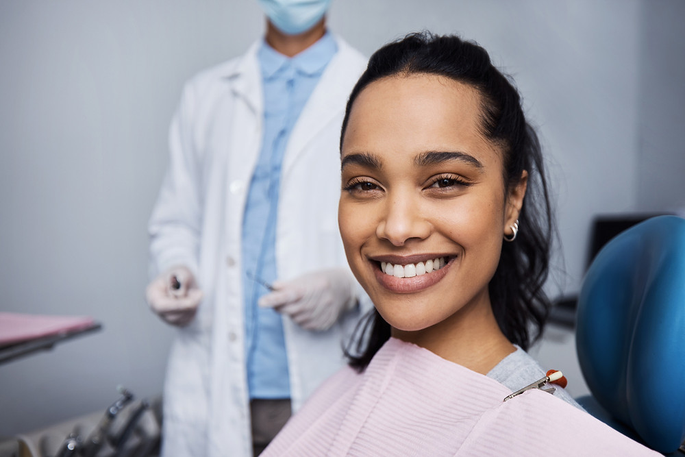 Person at dentist smiling with teeth whitening | CARRAWAY FAMILY AND COSMETIC DENTISTRY
