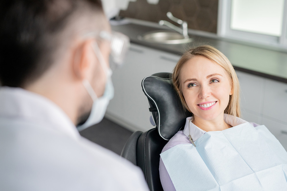Person at dentist for tooth extraction | CARRAWAY FAMILY AND COSMETIC DENTISTRY