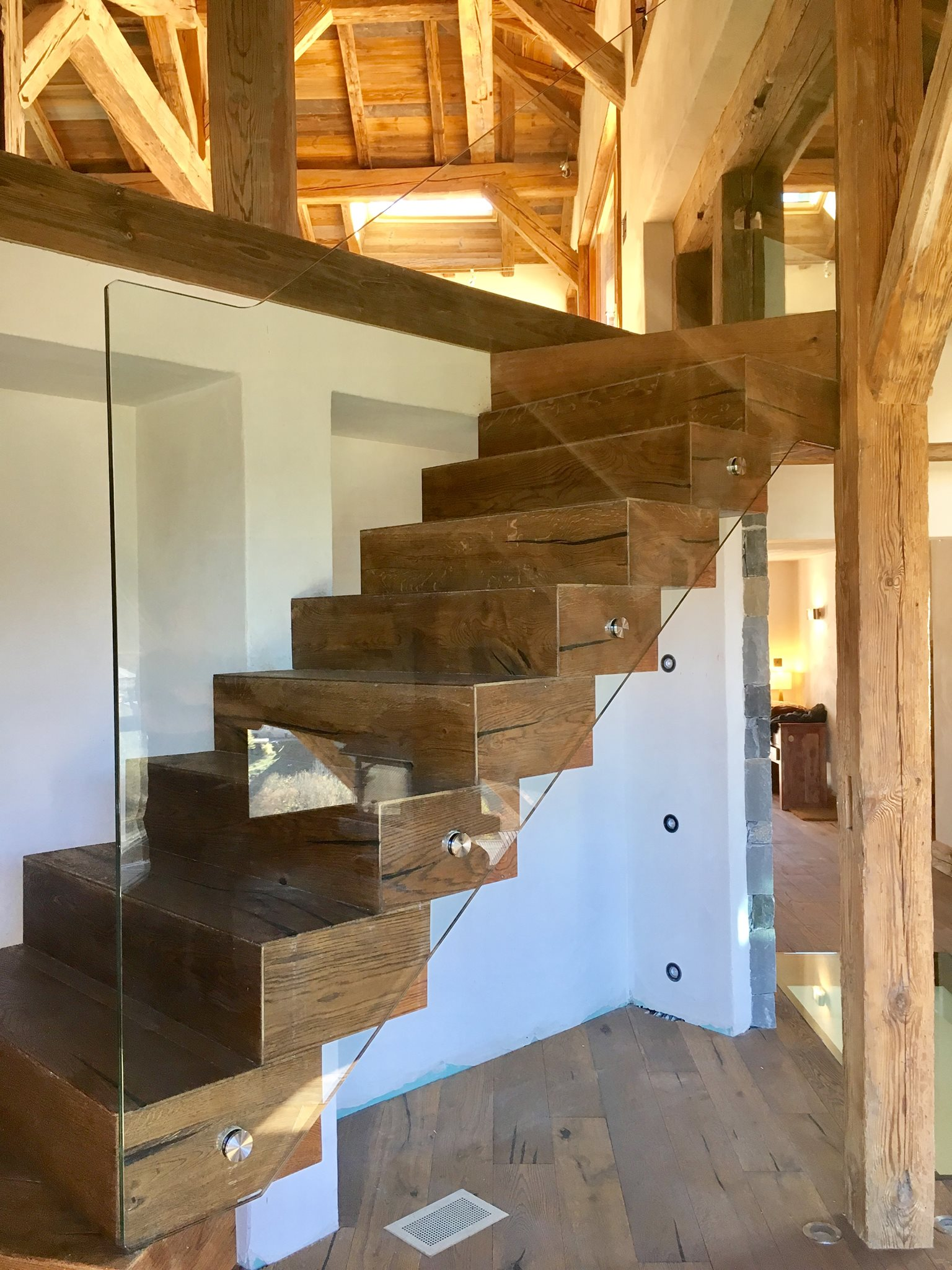 Glasswork with old wood stairs