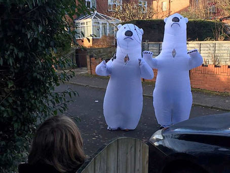 Grandparents Finally Get to Hug Grandkids After 9 Months Thanks to Inflatable Polar Bear Costumes
