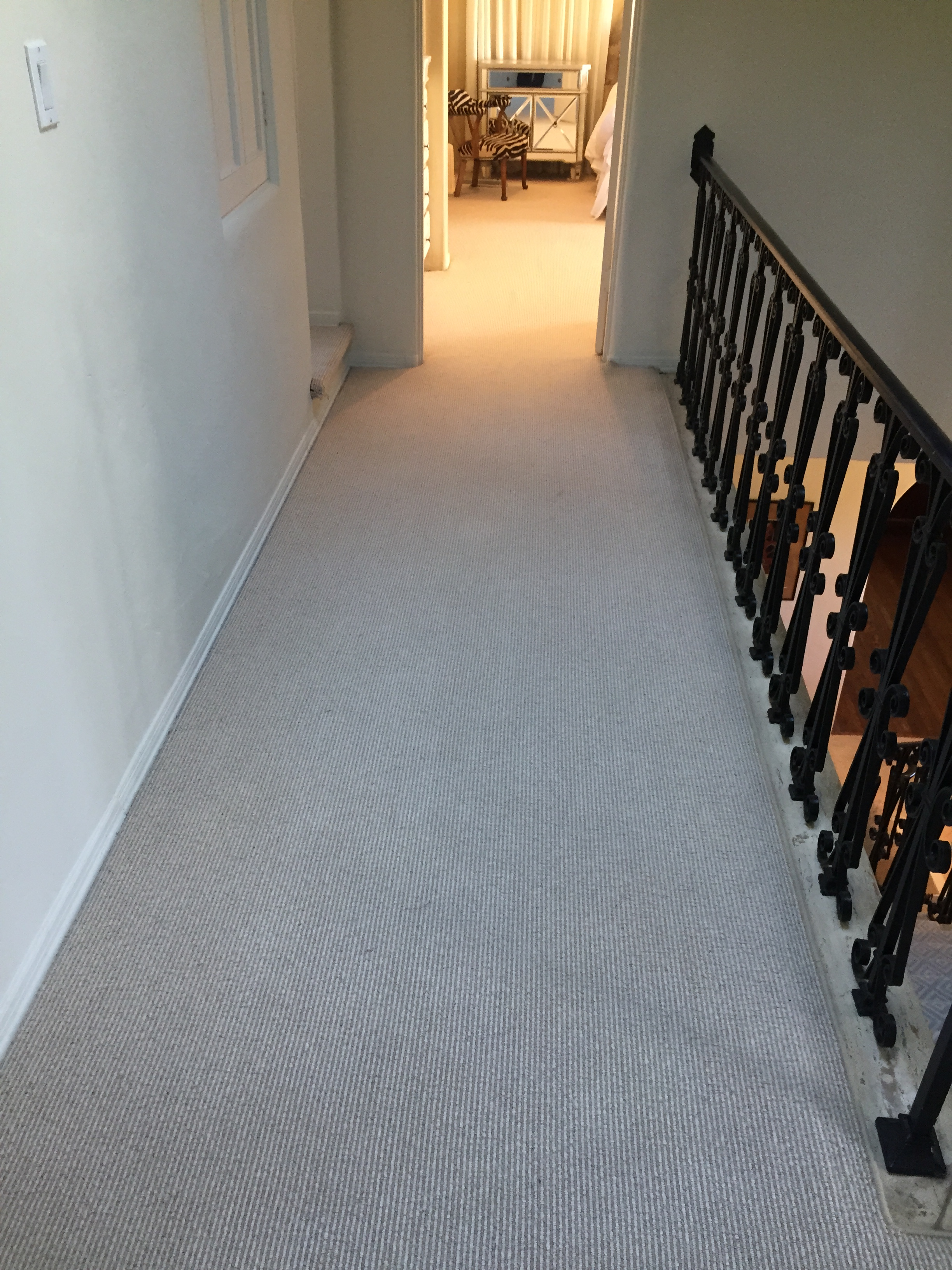 Hallway carpeted before