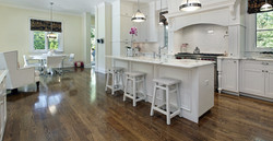 Large kitchen in luxury home with white cabinetry_edited