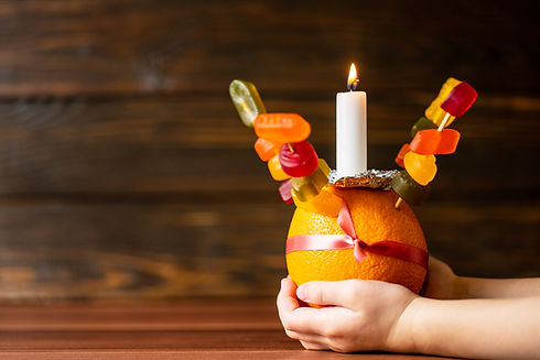 Orange Christingle is a symbolic object used in the Advent, Christmas and Epiphany service