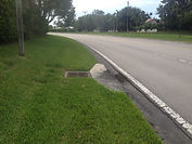 Lyons Road drain on side of the road