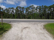 SR 5 dirt road that merges into a paved road