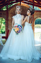 Two Brides in Wedding Gowns