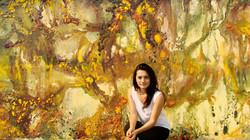 Artist with artwork