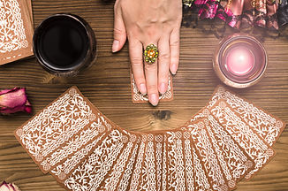 Fortune teller female hands and tarot ca