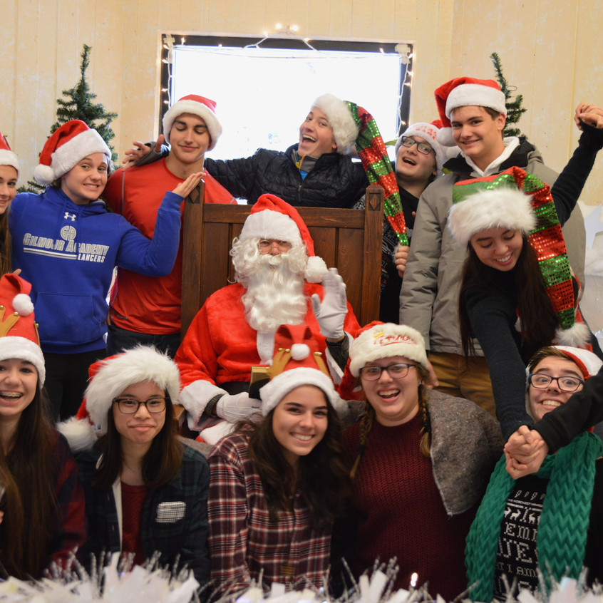 M.A.D. Club volunteers pose together with Santa Claus after the breakfast to celebrate their success!