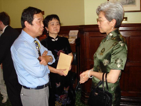 President Dr Huijun Shen and public relation executive Dr Dan Jiang were in discussion with Chinese ambassador Ms Fu at the reception of TCM in parliament before TCM week 2013