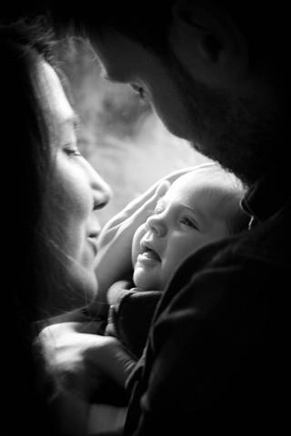 photo de bébé et parents à domicile