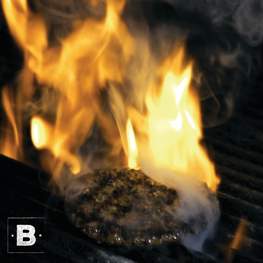 Flame Broiling burgers at Barlows
