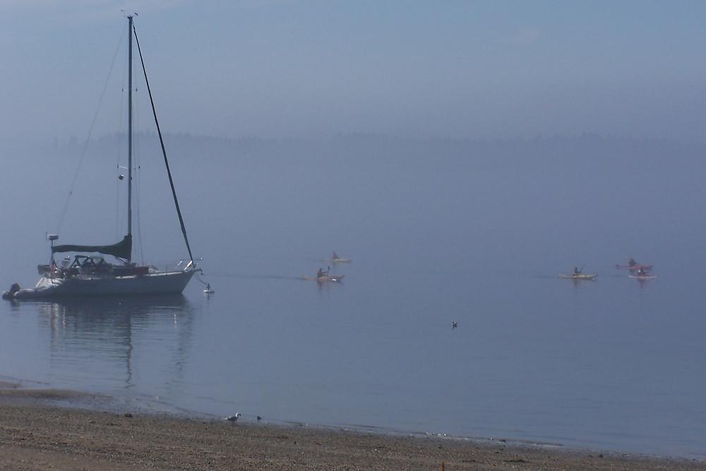 Morning fog kayakers at Blake Island State Park