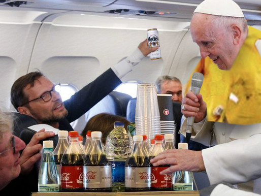 Pope fulfills lifelong dream to be flight attendant on trip to Baghdad