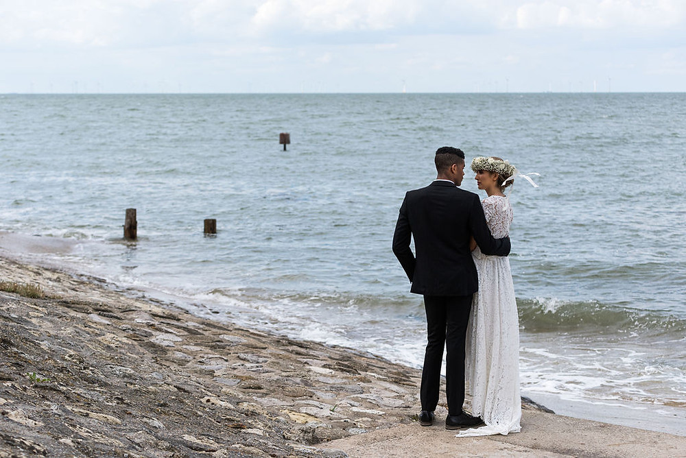 Tony Pullen Photography | Bride and groom embracing by the sea